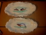 white china plates with pictures of fish