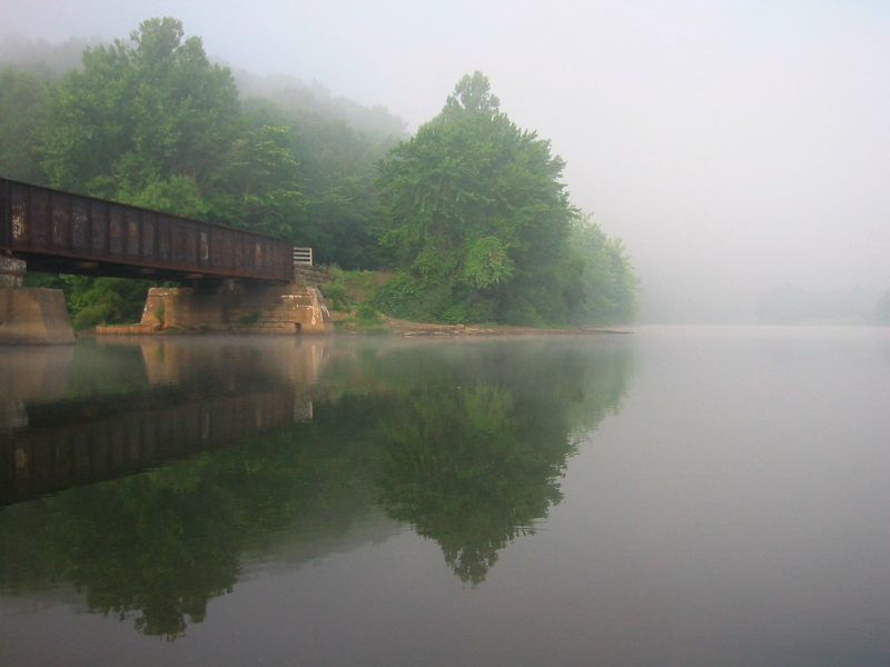 old railroad bridge along the Allegheny River on a misty morning